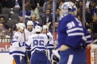 Tampa Bay Lightning right wing Nikita Kucherov (86) celebrates his goal with defenseman Mikhail Sergachev (98), defenseman Victor Hedman (77), and center Steven Stamkos (91) during the first period of an NHL hockey game Thursday, Oct. 10, 2019, in Toronto. (Cole Burston/The Canadian Press via AP)
