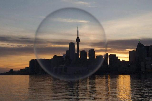 The Toronto skyline is seen through a soap bubble on Sunday April 9, 2017. (THE CANADIAN PRESS/Frank Gunn)