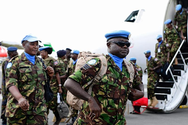 A group of Kenyan Defence Force {KDF} soldiers attached to the UN mission in South Sudan {UNMISS} arrive at Jomo Kenyatta Airport in Nairobi on November 9, 2016