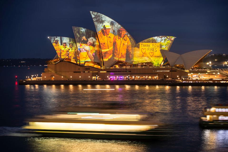 NEWS: A projection on the Sydney Opera House honours the hard work of firefighters during the current bushfire season. 11th January 2020, Photo: Wolter Peeters, The Sydney Morning Herald.