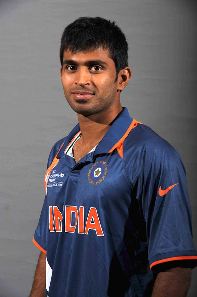 SANDTON, SOUTH AFRICA - SEPTEMBER 19:  Abhishek Nayar poses during the ICC Champions photocall session of India at Sandton Sun on September 19, 2009 in Sandton, South Africa. (Photo by Lee Warren/Gallo Images/Getty Images)