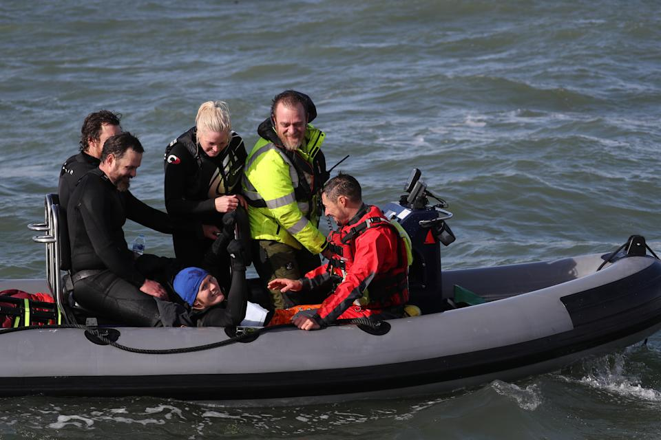 Former paratrooper John Bream (centre, wearing blue hat) is picked up from the water following his attempt at a record for highest jump without a parachute by jumping 200ft from a helicopter into the sea off Hayling Island in Hampshire. (Photo by Andrew Matthews/PA Images via Getty Images)