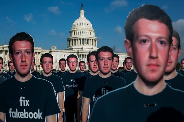 100 life-sized cutouts of Facebook CEO Mark Zuckerberg sit on the lawn of the U.S. Capitol on April 10. in Washington, DC. The advocacy group Avaaz placed the cutouts on the lawn to bring attention to the alleged hundreds of millions of fake accounts still spreading disinformation on Facebook ahead of Zuckerberg's hearing before the Senate comittees. (Photo by Zach Gibson/Getty Images)
