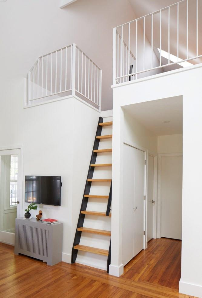 """<div class=""""caption""""> The ladder leads to the former attic, which had been """"a completely unused dead space,"""" says Sarah. """"We opened it up to create an extra bedroom."""" </div>"""