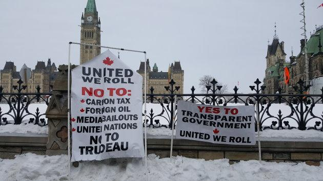 "Many signs were displayed as part of the ""United We Roll"" convoy rally on Parliament Hill in Ottawa on Feb. 20, 2019."