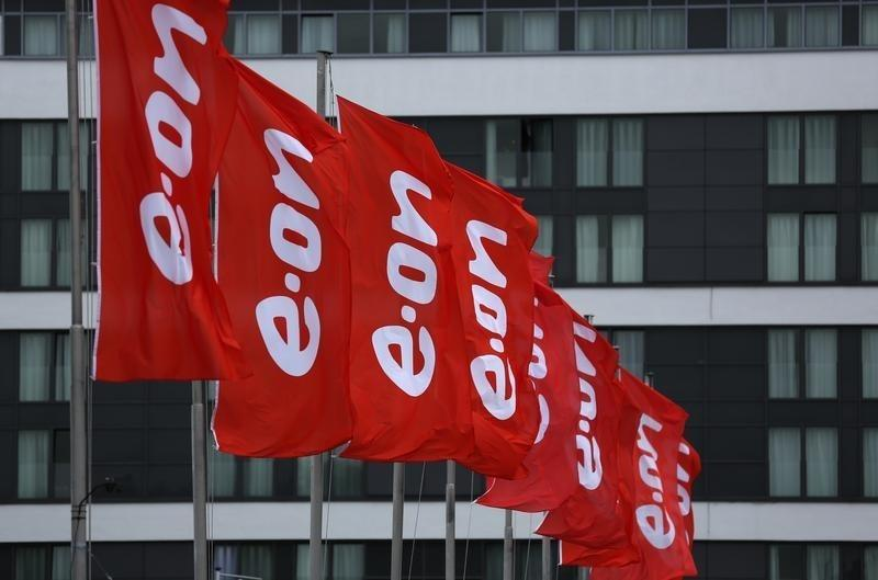 Flags of E.ON are seen before the annual meeting of German utility giant E.ON in Essen
