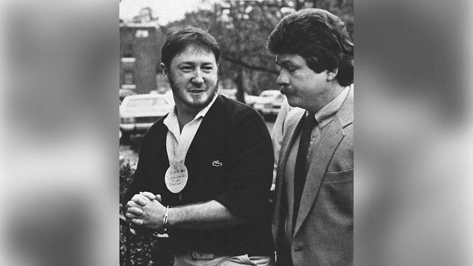 Larry Gene Bell, left, arrives at the Berkeley County courthouse on Feb.11, 1986, for jury selection in his trial on charges of murder and kidnapping in the 1985 slaying of Lexington County teenager Shari Faye Smith. Bell wore a circular paper clipped to his shirt that read, 'I am the victim Larry Gene Bell. I am innocent.'