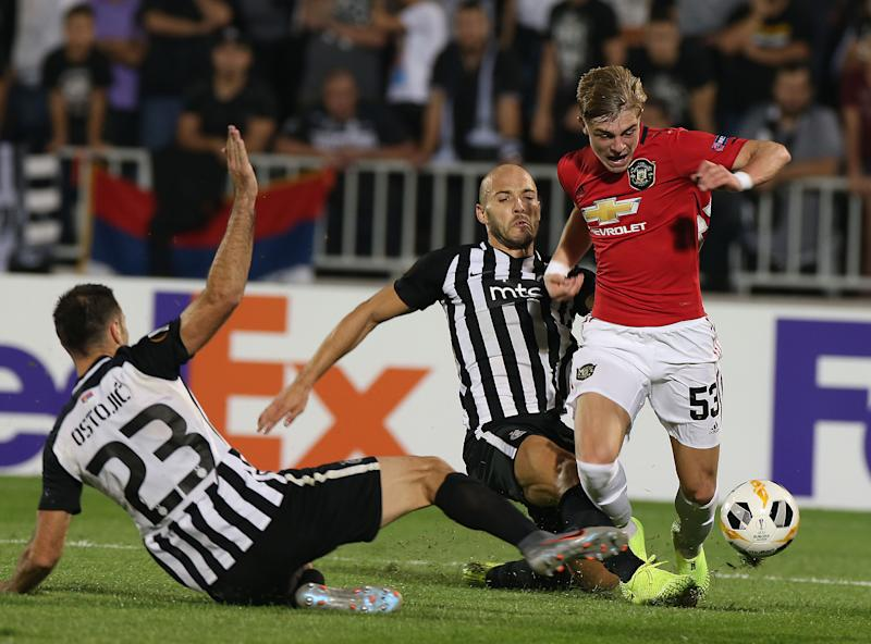 BELGRADE, SERBIA - OCTOBER 24: Brandon Williams of Manchester United in action with Nemanja Miletic and Bojan Ostojic of Partizan Belgrade during the UEFA Europa League group L match between Partizan and Manchester United at Partizan Stadium on October 24, 2019 in Belgrade, Serbia. (Photo by Matthew Peters/Manchester United via Getty Images)