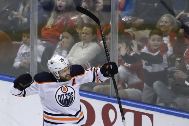 Edmonton Oilers center Leon Draisaitl (29) celebrates after scoring a goal during the third period of an NHL hockey game against the Florida Panthers, Saturday, Feb. 15, 2020, in Sunrise, Fla. (AP Photo/Lynne Sladky)