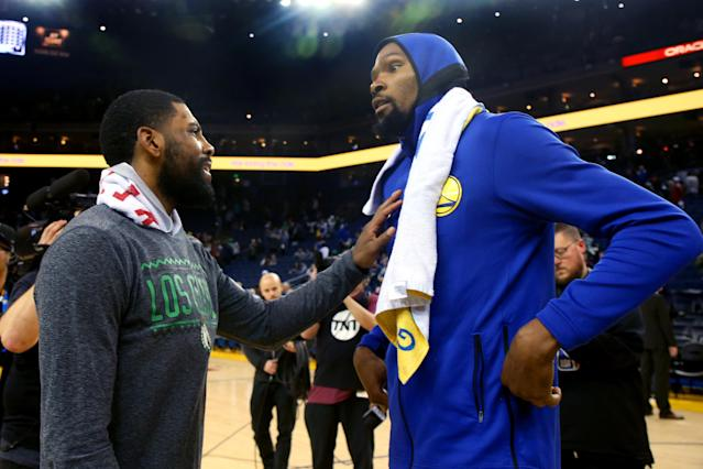 Kyrie Irving talks with Kevin Durant after a game March 5. (Photo by Ray Chavez/MediaNews Group/The Mercury News via Getty Images)