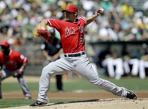 Los Angeles Angels' C.J. Wilson works against the Oakland Athletics in the first inning of a baseball game, Monday, Sept. 3, 2012, in Oakland, Calif. (AP Photo/Ben Margot)