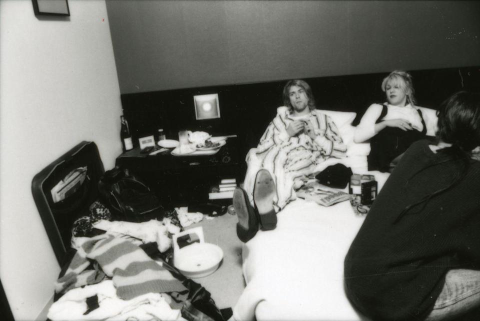 <p>Kurt Cobain and his wife, Courtney Love, lounge in their Tokyo hotel room during an interview in 1992. Love had recently given birth to the couple's daughter, Frances Bean, in August of that year. </p>
