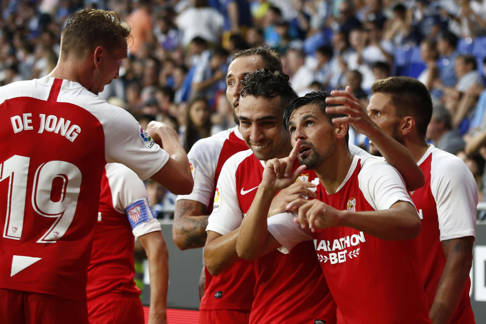 Sevilla's Nolito, 2nd from right, celebrates with team mates after scoring his side's second goal during the Spanish La Liga soccer match between Espanyol and Sevilla at the RCDE Stadium in Barcelona, Spain, Sunday Aug.18, 2019. (AP Photo/Joan Monfort)