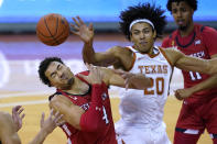 Texas Tech forward Marcus Santos-Silva (14) and Texas forward Jericho Sims (20) compete for a rebound during the first half of an NCAA college basketball game Wednesday, Jan. 13, 2021, in Austin, Texas. (AP Photo/Eric Gay)