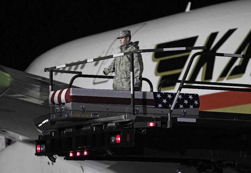 FILE - In this Feb. 2, 2012, file photo, the transfer case containing the remains of Marine Lance Cpl. Edward J. Dycus, 22, of  Greenville, Miss., sits at the end of the loader ramp, upon arrival at Dover Air Force Base, Del. An Afghan soldier shot to death Dycus at an outpost in southwestern Afghanistan in February in a previously undisclosed case of Afghan treachery that marked at least the seventh killing of an American military member by his supposed ally in the past six weeks, Marine officials said. (AP Photo/Jose Luis Magana, File)