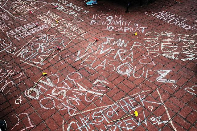 <p>The names of shooting victims are written in chalk in a park across from the historic gay and lesbian bar the Stonewall Inn in New York City on June 13, 2016. An American-born man who had recently pledged allegiance to ISIS, the so-called Islamic State, killed 50 people early Sunday at a gay nightclub in Orlando. The massacre is the deadliest mass shooting in U.S. history. (Photo: Spencer Platt/Getty Images) </p>