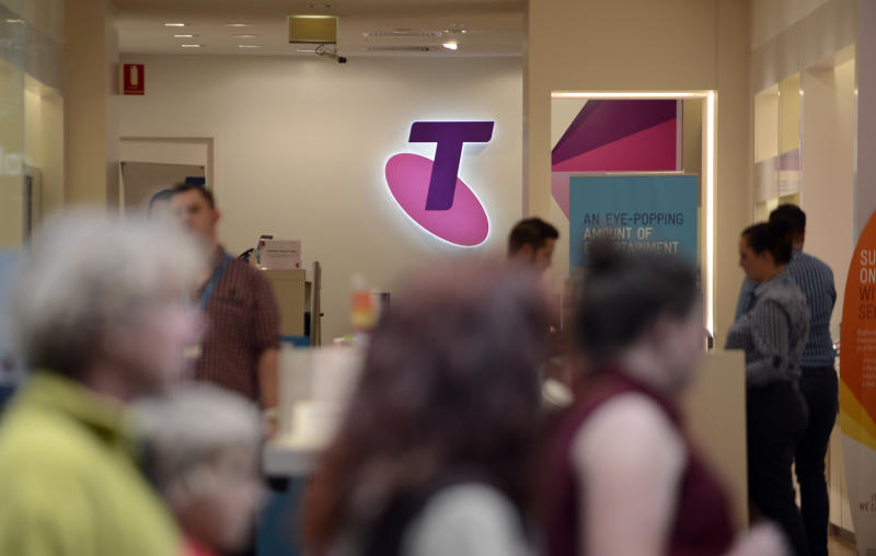 A Telstra shop with customers.