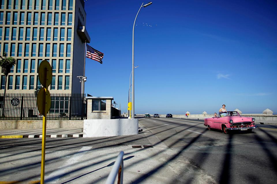 Image: FILE PHOTO: Tourists in a vintage car pass by the U.S. Embassy in Havana (Alexandre Meneghini / Reuters)