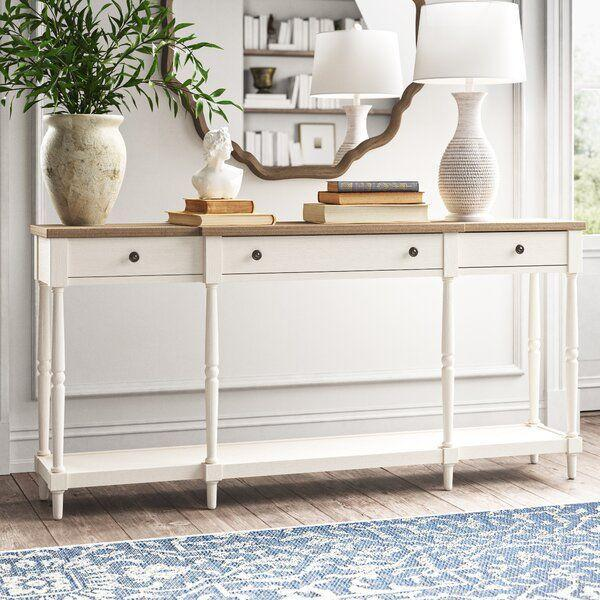 "<p><strong>Kelly Clarkson Home</strong></p><p>wayfair.com</p><p><strong>$469.99</strong></p><p><a href=""https://go.redirectingat.com?id=74968X1596630&url=https%3A%2F%2Fwww.wayfair.com%2Ffurniture%2Fpdp%2Fkelly-clarkson-home-belfort-70-console-table-w003318204.html&sref=https%3A%2F%2Fwww.housebeautiful.com%2Fshopping%2Fbest-stores%2Fg33969819%2Fkelly-clarkson-home-wayfair-fall-2020%2F"" rel=""nofollow noopener"" target=""_blank"" data-ylk=""slk:BUY NOW"" class=""link rapid-noclick-resp"">BUY NOW</a></p><p>""To me, good furniture is a piece that can become anything you need it to be. This console table has tons of storage and is perfect behind a sofa, in the entryway, or even as a bar!"" </p>"