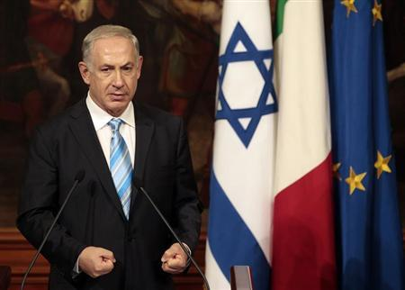 Israel's Prime Minister Benjamin Netanyahu gestures during a joint news conference with his Italian counterpart Enrico Letta during a meeting at Chigi Palace in Rome