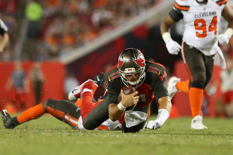 TAMPA, FL - AUG 23: Blaine Gabbert (11) of the Bucs goes down and injures his shoulder on this run during the preseason game between the Cleveland Browns and the Tampa Bay Buccaneers on August 23, 2019 at Raymond James Stadium in Tampa, Florida. (Photo by Cliff Welch/Icon Sportswire via Getty Images)