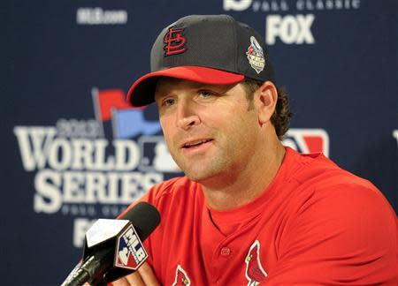 Oct 22, 2013; Boston, MA, USA; St. Louis Cardinals manager Mike Matheny (22) speaks to the media on the day before game one of the World Series against the Boston Red Sox at Fenway Park. Bob DeChiara-USA TODAY Sports