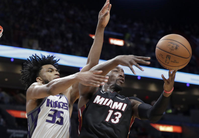 Sacramento Kings forward Marvin Bagley III (35) and Miami Heat center Bam Adebayo (13) go for a loose ball during the first half of an NBA basketball game, Monday, Jan. 20, 2020, in Miami. (AP Photo/Lynne Sladky)