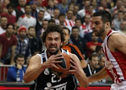 Sergio Llull (left) drives to the basket in a Euroleague game. (AP)