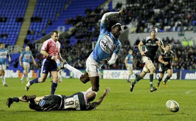 Toulon's English winger Paul Sackey (R) is tackled by London Irish's English scrum-half Paul Hodgson (L) during the Heineken Cup rugby union match between London Irish and Toulon at The Madejski Stadium in Reading on December 12, 2010. AFP PHOTO / GLYN KIRK (Photo credit should read GLYN KIRK/AFP/Getty Images)