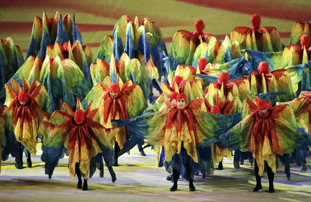 <p>Costumed dancers perform during the closing ceremony in the Maracana stadium at the 2016 Summer Olympics in Rio de Janeiro, Brazil, Sunday, Aug. 21, 2016. (AP Photo/Charlie Riedel) </p>