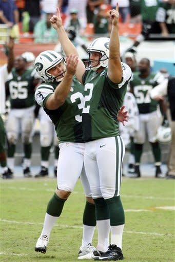 New York Jets punter Robert Malone (3) congratulates kicker Nick Folk (2) after Folk kicked a field goal during overtime of an NFL football game against the Miami Dolphins, Sunday, Sept. 23, 2012, in Miami. The Jets won 23-20. (AP Photo/Wilfredo Lee)