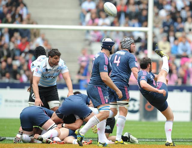 Stade Français' French flanker David Lyons (R) kicks the ball during the French Top 14 rugby union match Stade Francais vs. Racing Metro on May 5, 2012 at the Charlety stadium in Paris. AFP PHOTO / FRANCK FIFEFRANCK FIFE/AFP/GettyImages