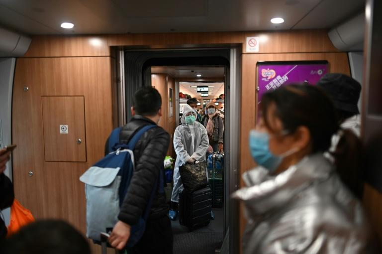 With the virus outbreak deemed under control, rules have been eased to allow people to enter Wuhan (AFP Photo/HECTOR RETAMAL)