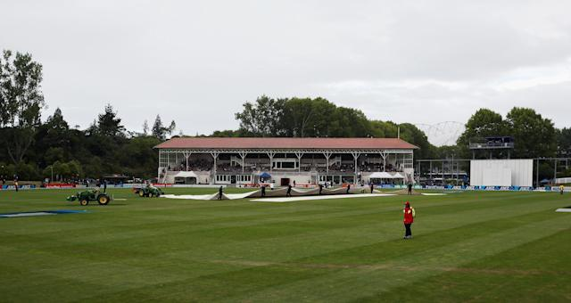 DUNEDIN, NEW ZEALAND - DECEMBER 07: Ground staff bring on the covers due to rain during day five of the first test match between New Zealand and the West Indies at University Oval on December 7, 2013 in Dunedin, New Zealand. (Photo by Rob Jefferies/Getty Images)