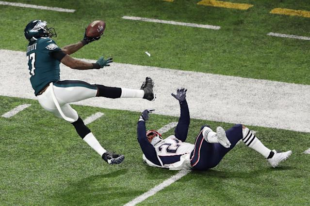<p>Alshon Jeffery #17 of the Philadelphia Eagles bobbles the pass under pressure from Stephon Gilmore #24 of the New England Patriots as teamamte Duron Harmon #30 (not pictured) intercepts the ball in Super Bowl LII at U.S. Bank Stadium on February 4, 2018 in Minneapolis, Minnesota. (Photo by Christian Petersen/Getty Images) </p>