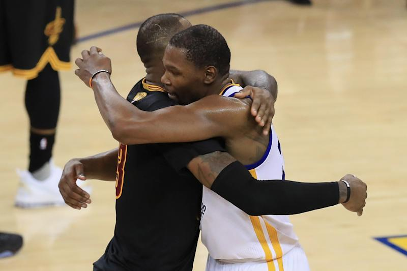LeBron James and Kevin Durant embrace after the Warriors' title-clinching Game 5 win. (Getty Images)