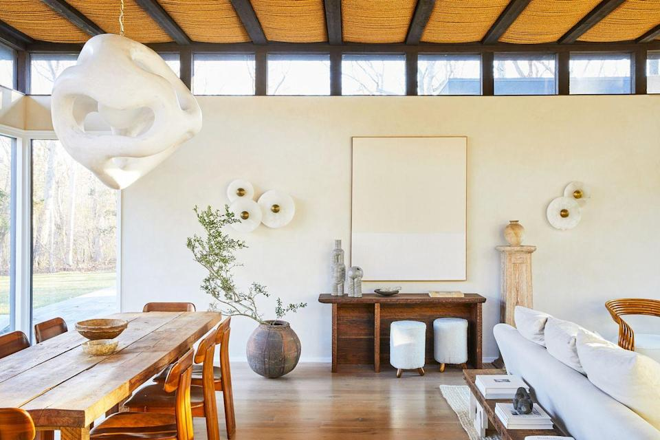 <p>Sculptural, understated, and decidedly avant garde accents are the name of the game in Athena Calderone's living room. A rustic wood console is the perfect surface for sculptural vases and a catch-all (in this case, for palo santo) as well as a good place to tuck some extra seating under—always a good idea in a host's entertaining space. </p>