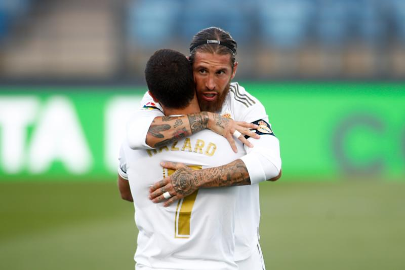 Sergio Ramos celebrates a goal and hugs Eden Hazard.