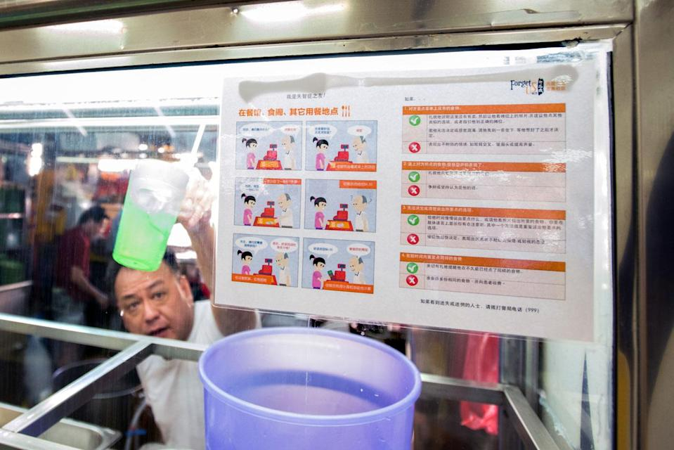 A hawker stall bearing a sign that offers advice on how to deal with patients suffering from dementia. (PHOTO: Stefanus Ian for Yahoo News Singapore)