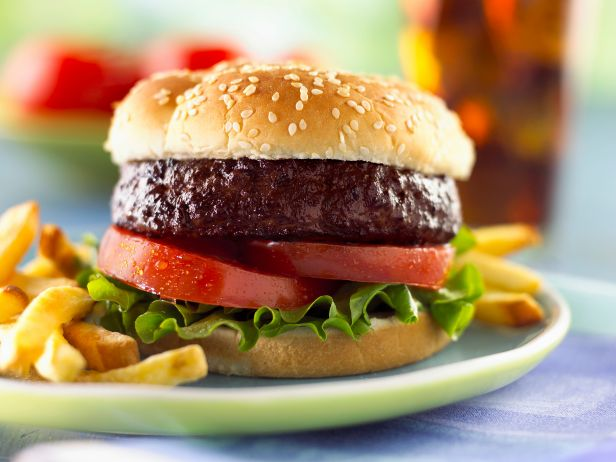 """<p>A heavy, fatty meal like a burger gets your digestive tract working hard, which can be disruptive if you're trying to get to sleep. <a href=""""http://www.ncbi.nlm.nih.gov/pubmed/26156950"""" rel=""""nofollow noopener"""" target=""""_blank"""" data-ylk=""""slk:A recent study"""" class=""""link rapid-noclick-resp"""">A recent study</a> found that eating too much saturated fat is linked to lighter sleep with more wakefulness.</p>"""