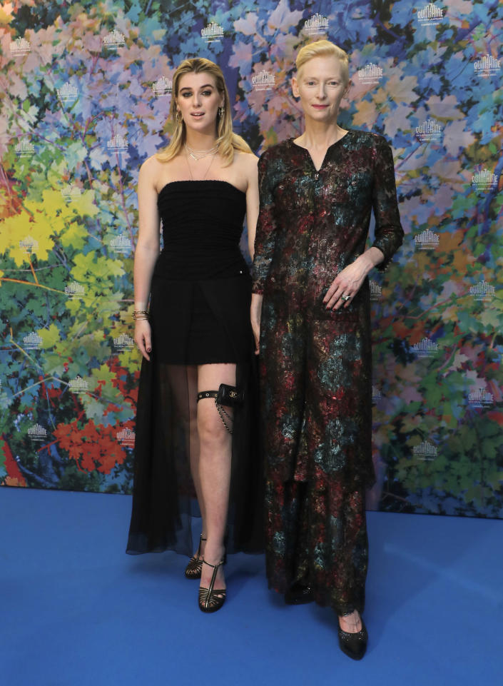 Honor Swinton Byrne, left, and Tilda Swinton pose for photographers at the photo call for the film 'The Souvenir- Part II' at the 74th international film festival, Cannes, southern France, Thursday, July 8, 2021. (Photo by Vianney Le Caer/Invision/AP)