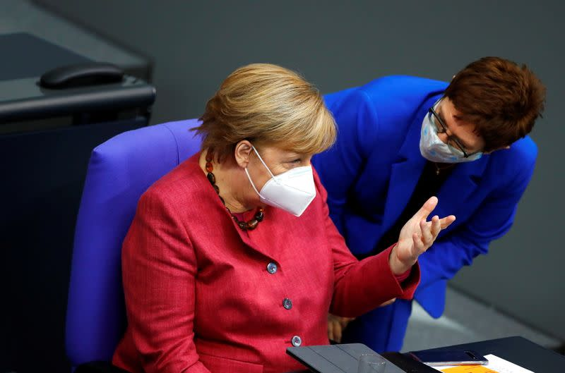 German Chancellor Angela Merkel attends a session of the Bundestag, in Berlin