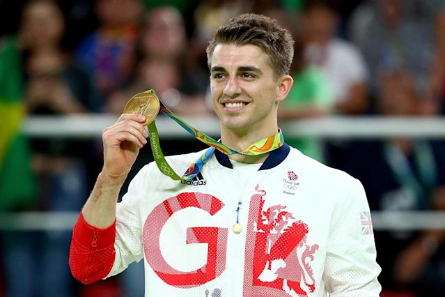 <p>Gold medalist Max Whitlock of Great Britain celebrates on the podium at the medal ceremony for Men's Floor Exercise on Day 9 of the Rio 2016 Olympic Games at the Rio Olympic Arena on August 14, 2016 in Rio de Janeiro, Brazil. (Photo by Alex Livesey/Getty Images) </p>