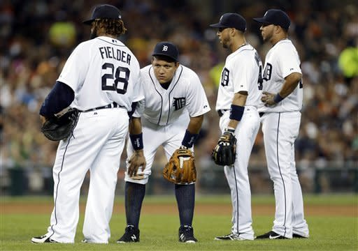 Detroit Tigers' Prince Fielder, from left, Miguel Cabrera, Omar Infante and Jhonny Peralta watch Octavio Dotel warm up against the Chicago White Sox in the sixth inning of a baseball game in Detroit, Friday, Aug. 31, 2012. (AP Photo/Paul Sancya)