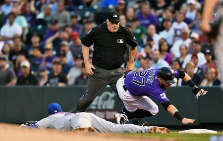 Jun 18, 2018; Denver, CO, USA; Colorado Rockies shortstop Trevor Story (27) is called out by first base umpire Bill Welke (3) in the fourth inning at Coors Field. Mandatory Credit: Ron Chenoy-USA TODAY Sports
