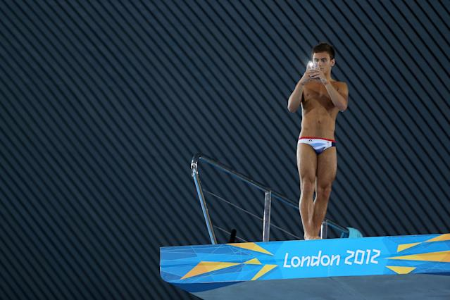 LONDON, ENGLAND - JULY 26: Tom Daley of Great Britain takes a picture from the diving platform with his camare on his smartphone during a training session ahead of the London Olympic Games at the Aquatics Centre in Olympic Park on July 26, 2012 in London, England. (Photo by Clive Rose/Getty Images)