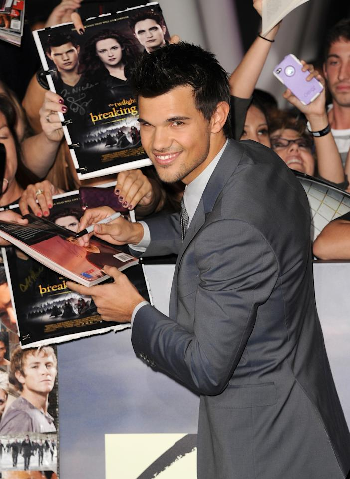 LOS ANGELES, CA - NOVEMBER 12:  Actor Taylor Lautner arrives at the premiere of Summit Entertainment's 'The Twilight Saga: Breaking Dawn - Part 2' at Nokia Theatre L.A. Live on November 12, 2012 in Los Angeles, California.  (Photo by Jason Merritt/Getty Images)