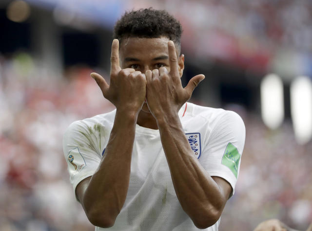 <p>England's Jesse Lingard reacts as he celebrates after scoring his team's third goal during the group G match </p>