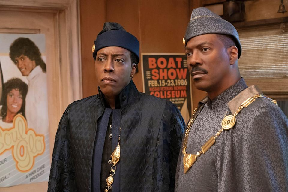 "Arsenio Hall (left) and Eddie Murphy reprise their roles as Semmi and Prince Akeem in the comedy sequel ""Coming 2 America."""