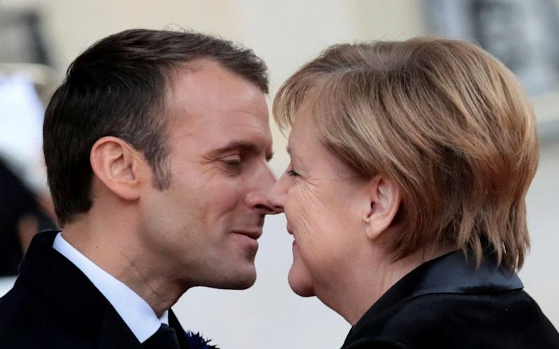 A French pensioner mistook Chancellor Angela Merkel of Germany for the wife of President Emmanuel Macron of France - REUTERS